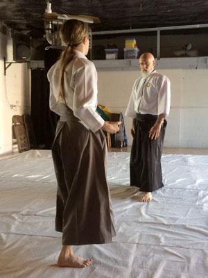 Man and Woman in Aikido Dojo