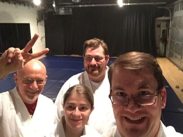 Aikido group selfie with the new mats