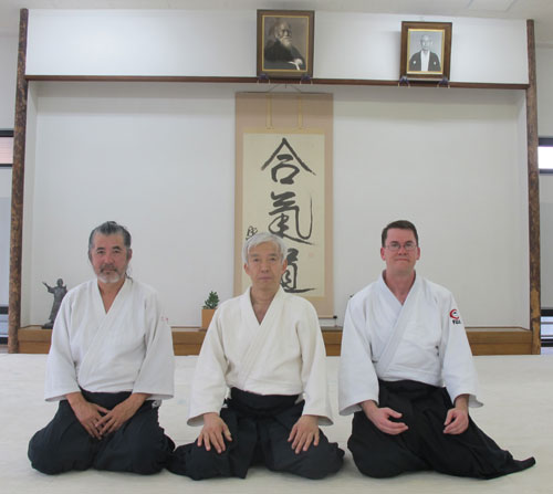 Men kneeling in dojo