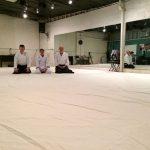 People Kneeling in Dojo