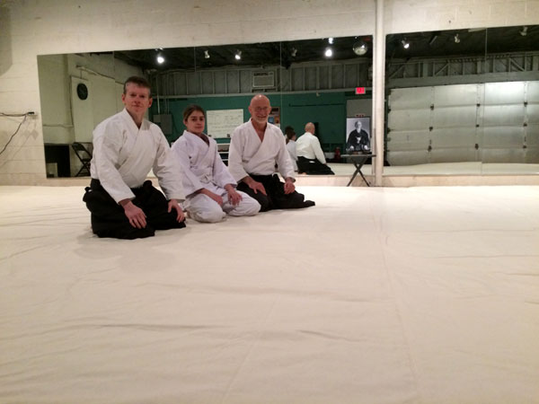 People Kneeling on Canvas Covered Mats
