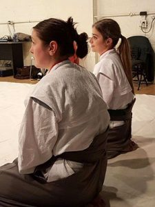 Two women in Aikido dojo